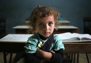 a Syrian refugee girl sits in a classroom at a Lebanese public school where only Syrian students attend classes in the afternoon, at Kaitaa village in north Lebanon.
